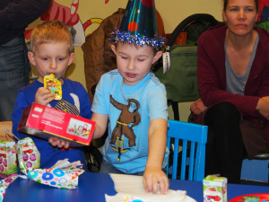 Ben with a friend opening gifts